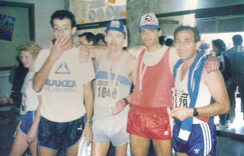 John Walsh (second from left) after finish of the first Malta Marathon in 1986. John is seen with Joe Farrugia to his right, Peter Borg Costanzi to his left and Charles Micallef St. John to his far left.
